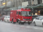 Kyoto firefighters under rain